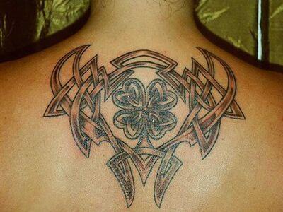 Irish celtic tattoo design on upperback body