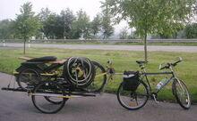 Airbike Pickup und Brompton auf Mountainbike Anhaenger