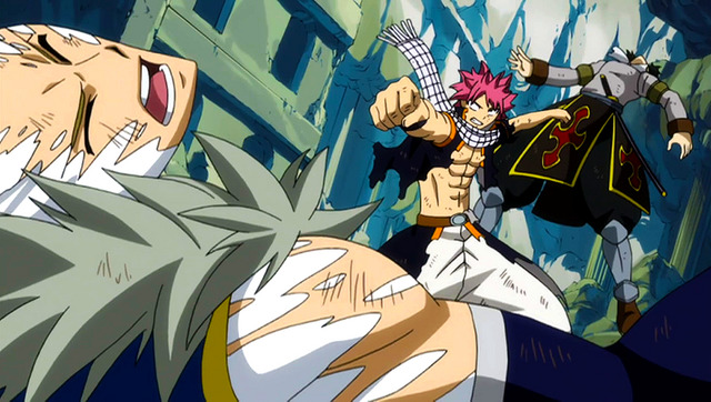 File:Natsu punches the Twin Dragons.png