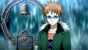 Loke stands next to Karen's grave