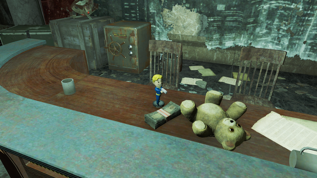 File:FO4 Small Guns Vault-Tec bobblehead in Gunners Plaza.png