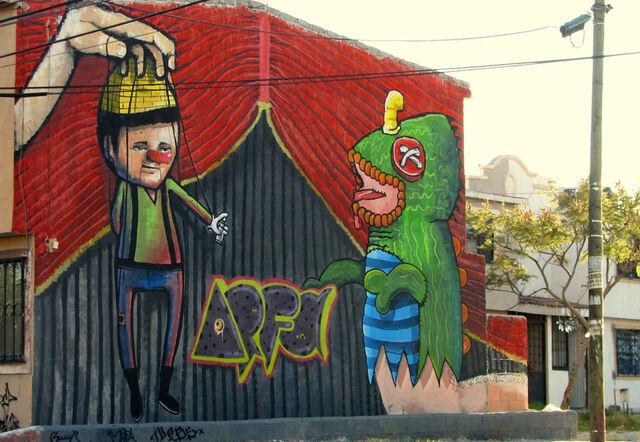 File:Wall graffiti making int he wall.jpg