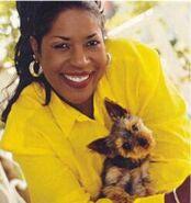 Jo Marie Payton (holding the dog)