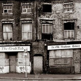 Hiver Street, which began to stagnate into a row of lowly shops in the mid-1960's, Chimney Hill. It was in the way of the construction of Green Ringway and was demolished soon after this picture was taken.