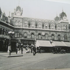 The Highbury Road Station, the only train station in Ambrose Green; downstairs is a small row of specialist shops (as well as a Boots to the left), offices on its first and second floors, and the terminals being behind the shops on the ground floor as well as on the basement floor (the tracks dig into a hill).