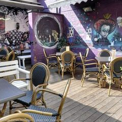 The beer garden (or, as the pub actually calls it, <i>sun trap</i>) thereof, known for its <i>Alice in Wonderland</i> wall paintings, atmosphere and space.