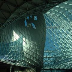 The shopping centre of Avenir Road, which stands directly next to the Ariel Tower and Avenir Road car park. Its dimension-bending roof proves to be one of its most recognisable idiosyncrasies and its main crown. There is a taller part of this building to the east, which connects it to the Ariel Tower by bridge.