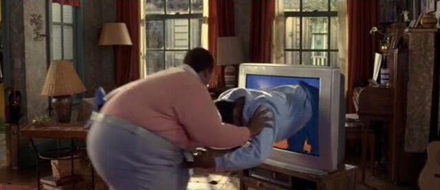 File:Fat Albert Pushing Bill Fat Into The Tv.jpg