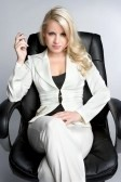 File:5704006-businesswoman-holding-cell-phone.jpg
