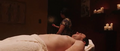 Isaac sleeping on the bed.png
