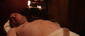 Isaac on the acupuncture massage table.png