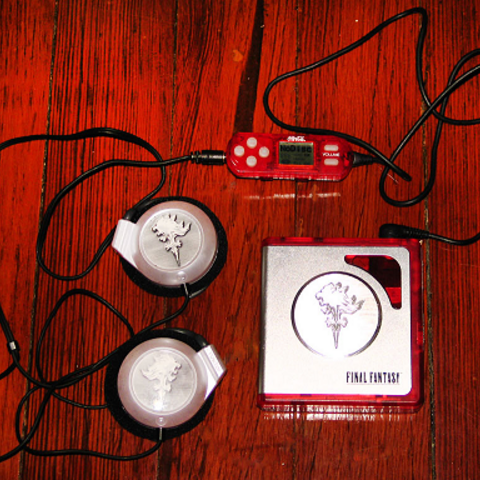 Coca-Cola minidisc player with Griever emblem.