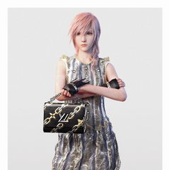 Lightning modelling a dress and a handbag from <a href=