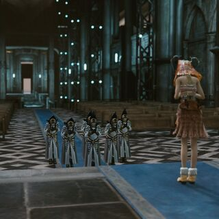 Vanille greets clerics in the Hall of Devotion.