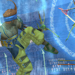 Wakka fending off Sahagin Chiefs during fiend raid on the stadium.