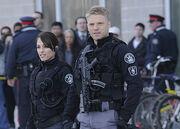 Julianna Callaghan (Amy Jo Johnson) and Sam Braddock (David Paetkau)