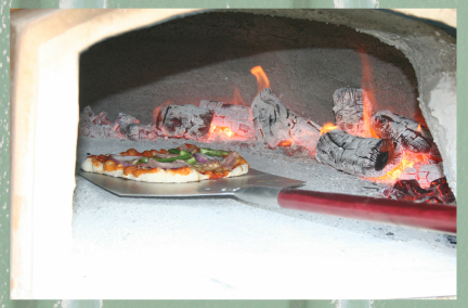 File:Wood fired pizzas3.jpg
