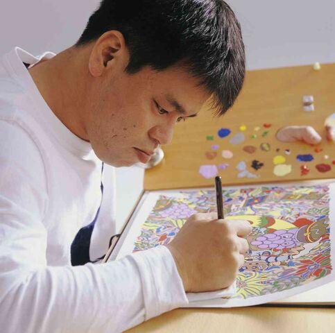 File:Onishi is drawing.jpg