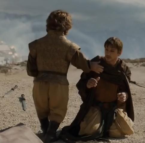 File:Yezzan zo Qaggaz kneels to Tyrion.png