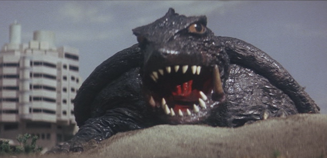 File:Gamera - 4 - vs Viras - 10 - The boys escape so Gamera gets ready to destroy the alien ship.png