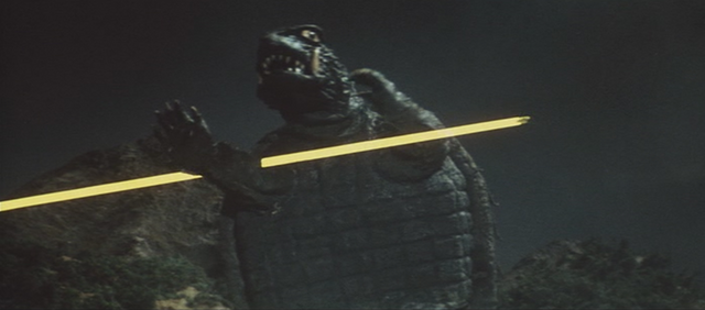 File:Gamera - 3 - vs Gyaos - 8 - Gamera becomes stupid and dances in front of the beam.png