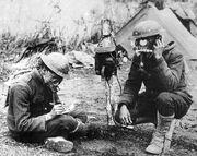 U.S. Signal Corpsmen Wearing Small Model Tissot Gas Masks