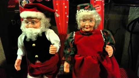 GEMMY ANIMATED DANCING CLAUS COUPLE SING AND SWING