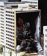 File:Cameraman in building.jpg