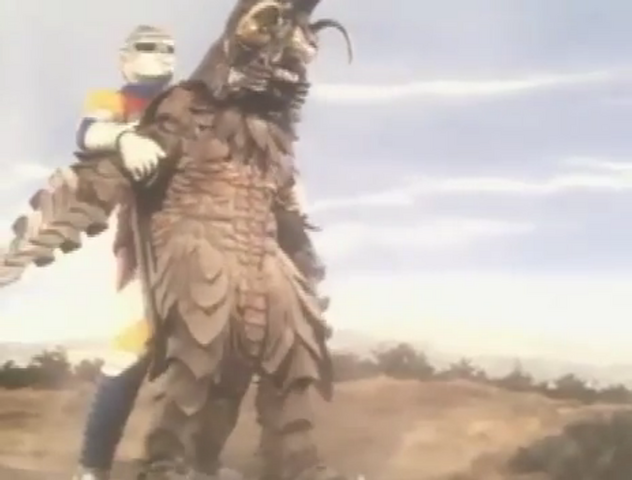 File:Godzilla vs. Megalon 10 - Jet Jaguar Holds Megalon.png