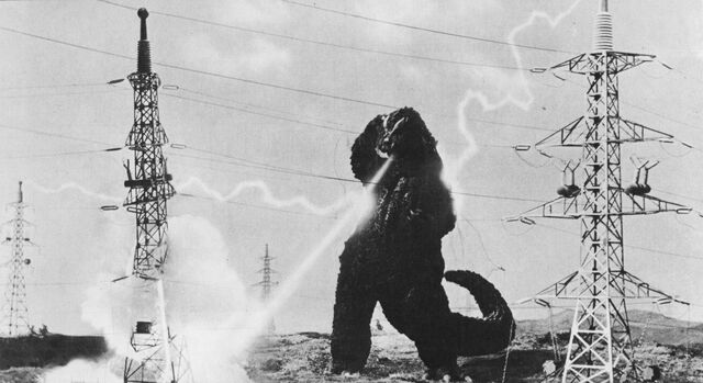 File:MVG - Godzilla Uses Radioactive Heat Ray On Transmission Tower.jpg