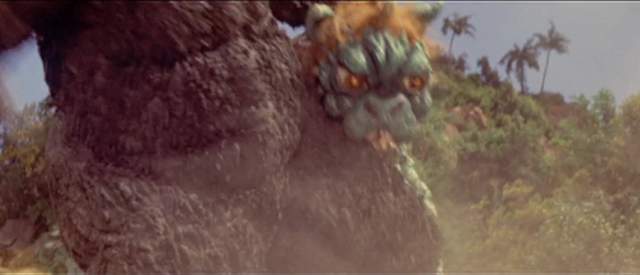 File:All Monsters Attack - Gabara has the BALLS to bite Godzilla.png