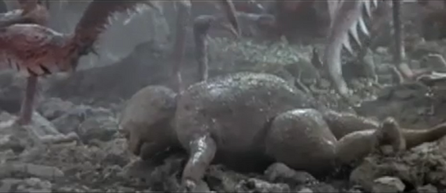 File:Son of Godzilla 3 - Kamacuras Discover Minilla.png