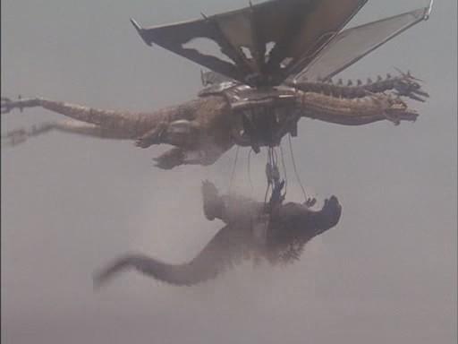 File:Mecha-King Ghidorah Carries Godzilla.jpg