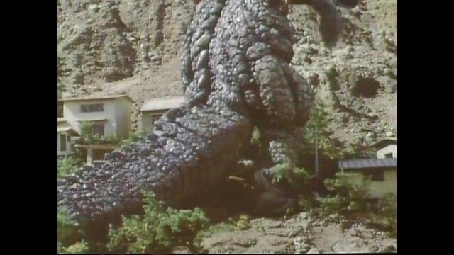 File:Gorosaurusstompingbuildings.jpg