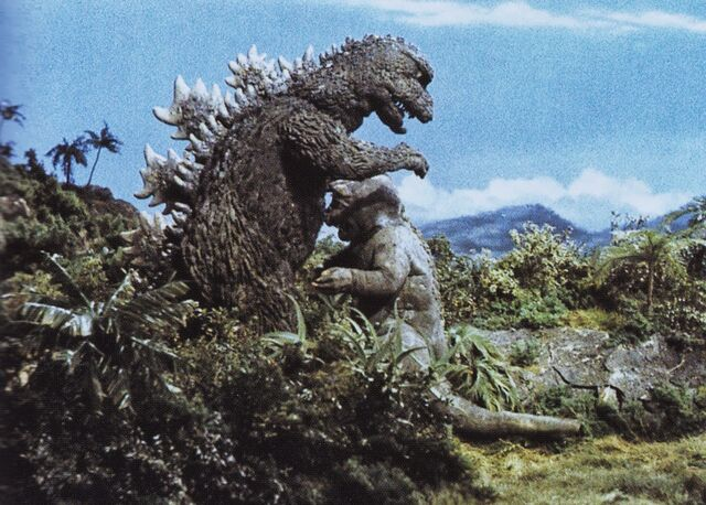 File:AMA - Minilla Running Up to Godzilla.jpg