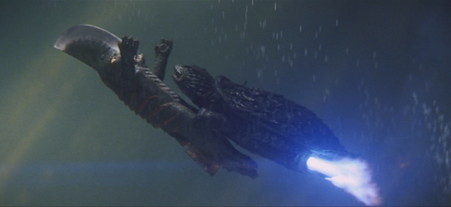 File:Gamera - 5 - vs Guiron - 41 - Gamera carries Guiron.png
