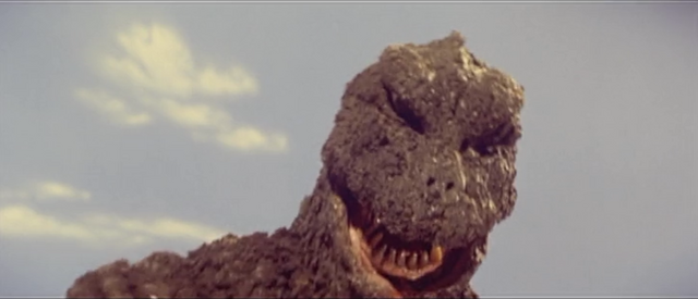 File:All Monsters Attack - Godzilla is in pain.png