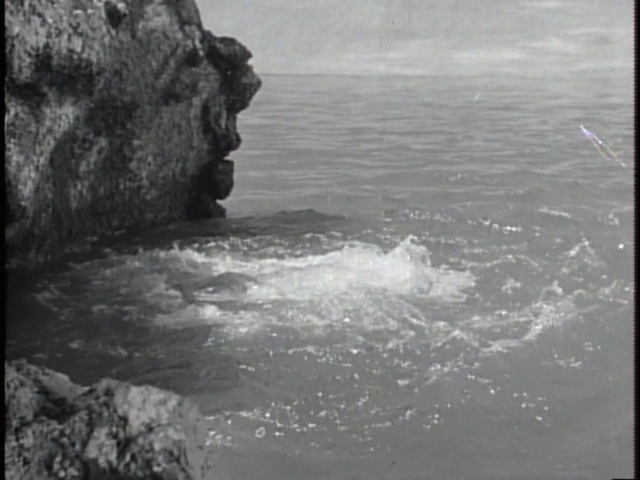 File:Godzilla Raids Again - 12 - The monsters fighting underwater, causing a spout of bubbling foam.png