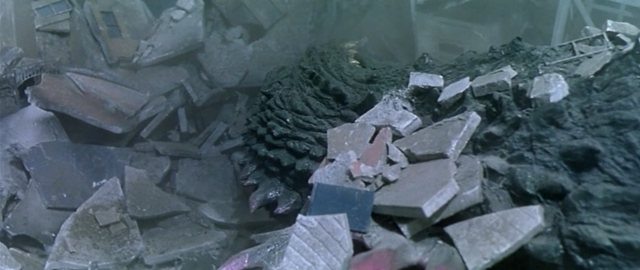 File:Godzilla vs. Megaguirus - Godzilla has some rubble on top of him.png
