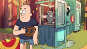 S1e9 man eating pretzel.png