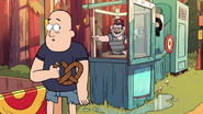 S1e9 man eating pretzel