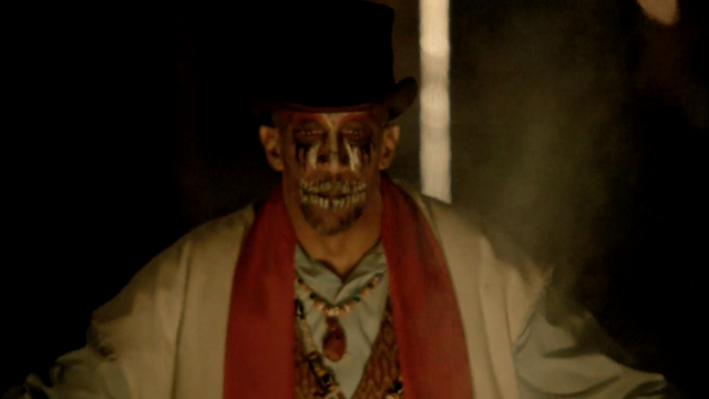 File:222-Baron Samedi about to set zombies loose.png