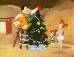Fred putting the star on the tree