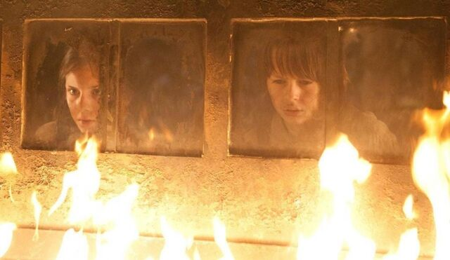 File:Staring at the witch as she burns.jpg