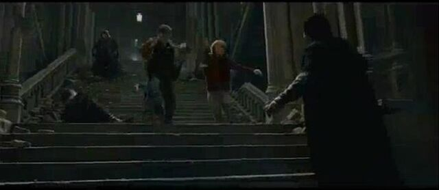 File:Trio dueling Battle og Hogwarts.jpg
