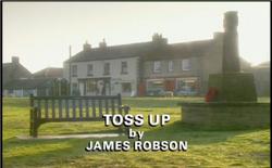 Toss Up title card