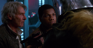 Finn, Chewbacca, and Han Solo capturing Captain Phasma