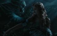 The Cheshire Cat bandaging Alice's arm