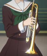 Kaori introducing a trumpet
