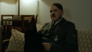Hitler sits in the badass way
